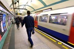Passengers travel on  London Underground platform Royalty Free Stock Photography