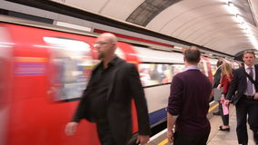 Passengers travel on London Underground platform stock video footage
