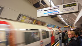 Passengers travel on London Underground platform stock footage