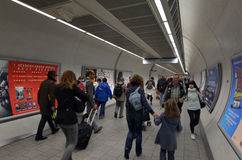 Passengers travel in  London Underground station. LONDON, UK - MAY 15 2015:Passengers travel in  London Underground station. The busiest station is Victoria Royalty Free Stock Image