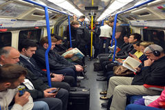 Passengers travel on  London Underground. LONDON, UK - MAY 15 2015:Passengers travel on  London Underground. The Annual passenger numbers of london Underground Stock Photo