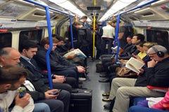 Passengers travel on  London Underground Stock Photo
