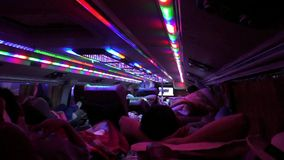 Passengers travel in a sleeping bus in Vietnam stock video