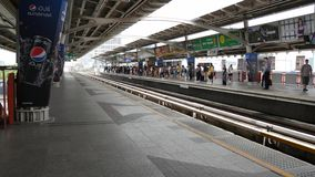 Passengers traveling at Mo Chit Sky Train Station BTS. Bangkok, Thailand - October 29, 2016 : Passengers traveling at Mo Chit Sky Train Station BTS on October 29 stock video