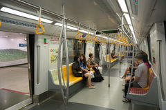 Passengers traveling on the subway in Singapore Stock Images
