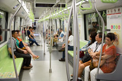 Passengers traveling on the subway in Singapore Royalty Free Stock Photo
