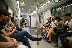 Passengers traveling on the subway in Singapore Royalty Free Stock Photography