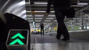 Passengers use horizontal airport escalator stock video footage