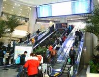 Passengers using escalator. At railway station  photoed on january 29th 2014 Stock Image