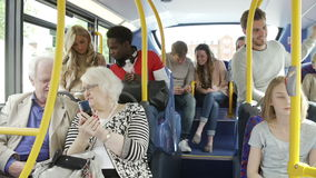 Passengers Using Mobile Devices On Bus Journey stock video footage