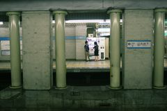 Passengers using vending machine on platform of a Toyko Subway Station.. Stock Photos