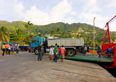 Passengers and vehicles disembarking from an inter-island ferry in the caribbean Stock Image