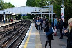 Passengers wait at District Line platform of Kew Gardens tube station London England Stock Images