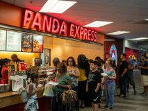 Free Passengers Wait In Line At Panda Express Fast Food Asian Restaurant Take Out In Food Court Royalty Free Stock Photography - 171231147