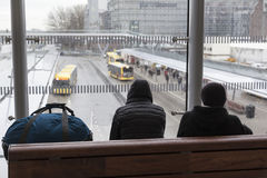 Passengers wait inside station for bus on rainy day in dutch cit Royalty Free Stock Photos