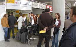 Airport passengers filling claims during a major flights delay. Passengers wait their turn to fill claims on the airport counter due to delays during a major stock image