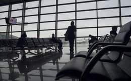 Passengers wait to board at departure lounge Stock Image