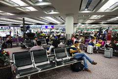 Passengers wait for the transit flight the airport lobby of Hong Stock Images