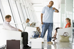 Passengers waiting in airport departure lounge Stock Photos