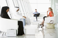 Passengers waiting in airport departure lounge Royalty Free Stock Photo