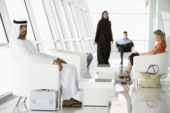 Passengers waiting in airport departure lounge stock image