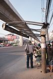 Passengers waiting for the arrival buses under ruined roof of the bus sto stock image