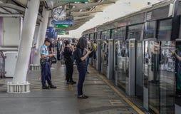 Passengers waiting at BTS Station in Bangkok stock image