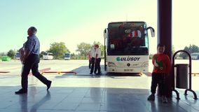 Passengers waiting the bus at Eskisehir Bus Terminal on a sunny day stock footage