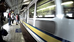 Passengers waiting for the coming train at station. Manila, Philippines - August 25, 2016: Passengers waiting for the coming train at station stock video