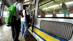 Passengers waiting for the coming train at station. Manila, Philippines - August 25, 2016: Passengers waiting for the coming train at station stock video footage