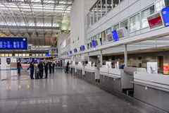Passengers waiting in a departures hall Royalty Free Stock Image