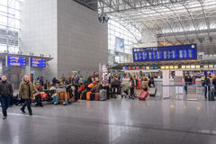 Passengers waiting in a departures hall Royalty Free Stock Photos