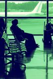 Passengers waiting for a flight Royalty Free Stock Photos