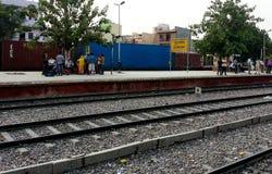 Passengers waiting at Gurgaon station Royalty Free Stock Image