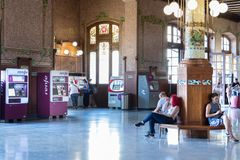 The passengers waiting hall and automatic ticket machines at the Valencia Train station - Estacion del Nord, Spain. Valencia, Spain - July 5th, 2018: The stock photo