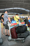 Passengers waiting at Jetstar Pacific Air check in counters Royalty Free Stock Image