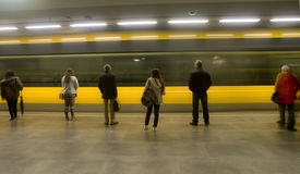 Passengers waiting on metropolitan platform Stock Image