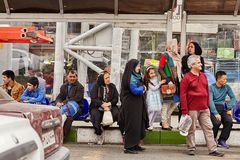Passengers are waiting for public transport at bus stop, Iran. Tehran, Iran - April 28, 2017: People waiting municipal transport at the bus stop royalty free stock photos