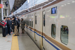 Passengers waiting for Shinkansen bullet train Royalty Free Stock Image