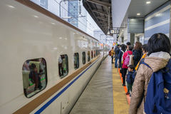 Passengers waiting for Shinkansen bullet train at Tokyo railway station Stock Image