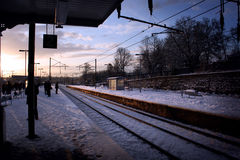 Passengers waiting on snow covered platform Royalty Free Stock Photo