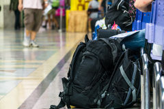 Passengers waiting in station. Backpack and passengers waiting in the station Royalty Free Stock Image