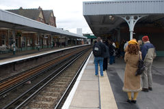 Passengers waiting for a train Royalty Free Stock Photo
