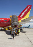 Passengers walk out on the stair from a plane of Vietjet Air Royalty Free Stock Photos