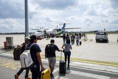 Passengers Walk To Board Airplane Royalty Free Stock Photo