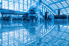 Passengers walking in the airport terminal Royalty Free Stock Image