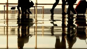 Passengers walking inside the airport terminal. Passengers walking inside the terminal stock footage