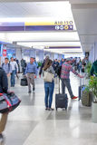 Passengers walking with lugagge in airport Royalty Free Stock Images
