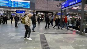 Passengers walking at the main railway station of Vienna. Vienna, Austria - December 20, 2016: Commuters walking at the main railway station of Vienna Wien stock video