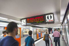 Passengers walking on a station platform Stock Images
